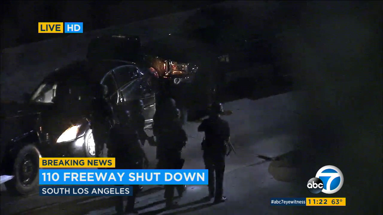 A suspect was arrested after officers shot him with a bean bag to end a standoff that shut down the southbound 110 freeway at Exposition Blvd.