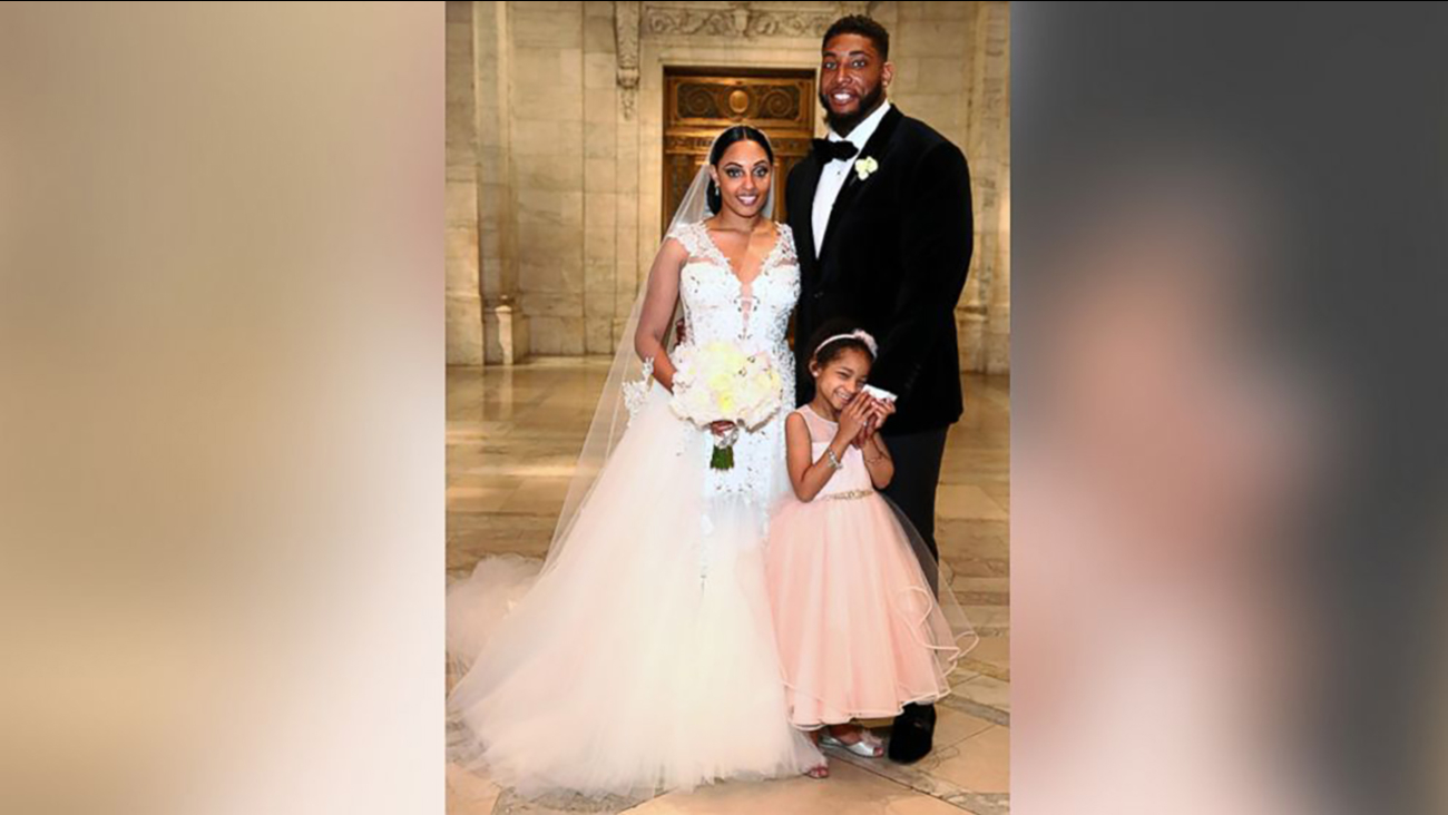 NEW YORK, NY - MAY 13: (L-R) Asha Joyce and husband Devon Still pose with daughter Leah Still after The Knot Dream Wedding - NFL Player Devon Still Marries Asha Joyce on May 13, 2016 in New York, New York.