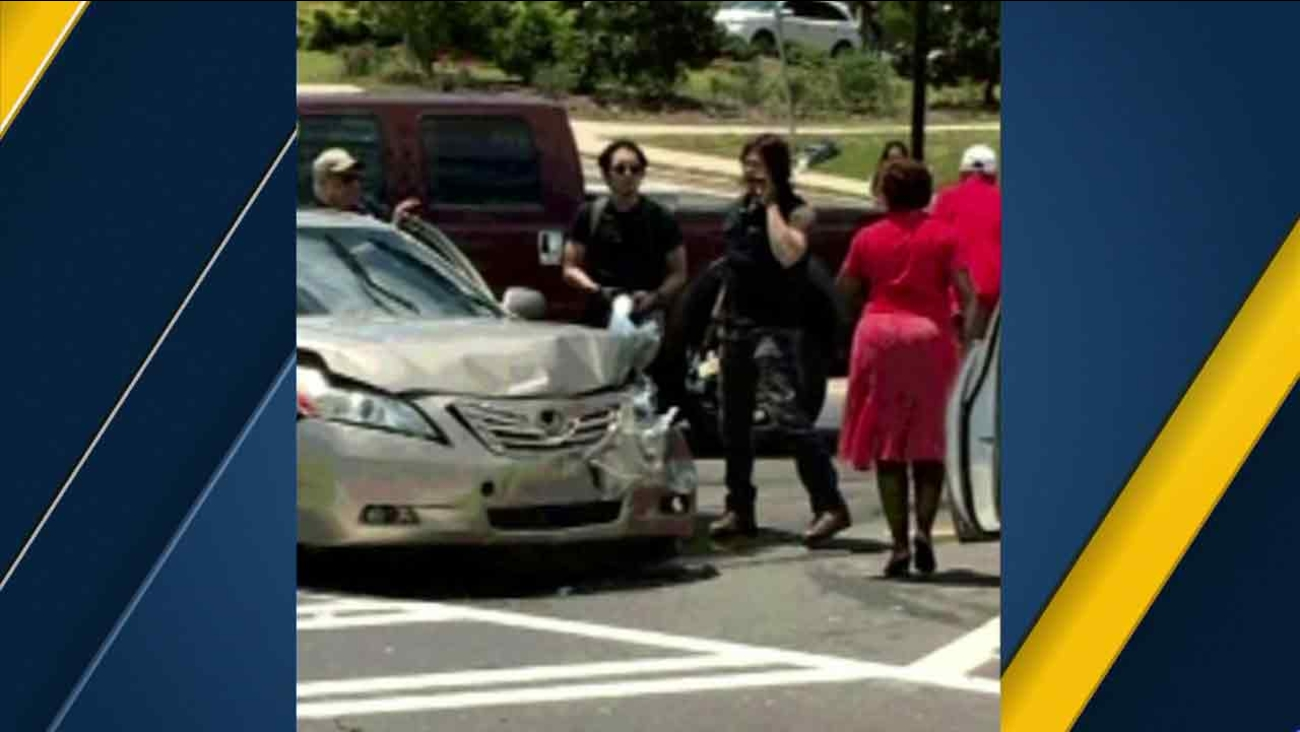 Norman Reedus and Steven Yeun at the scene of a car crash in Georgia in this undated photo.