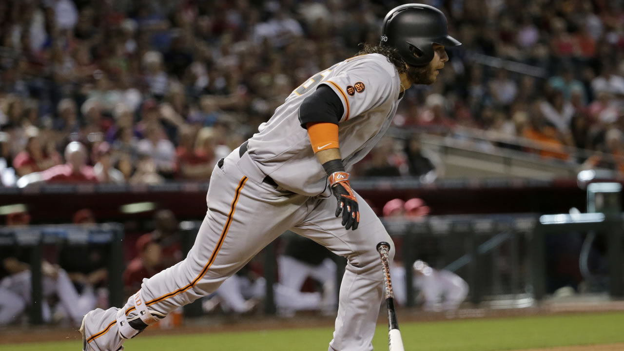 Giants' Brandon Crawford follows through on an RBI double against the Diamondbacks  during a game on Sunday, May 15, 2016, in Phoenix. (AP Photo/Matt York)