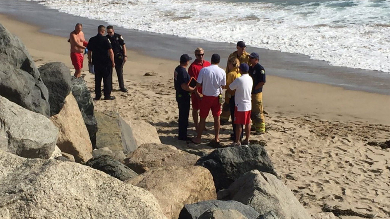 El Segundo firefighters and Los Angeles County lifeguards investigate after a man's body was found in El Segundo Sunday, May 15, 2016.