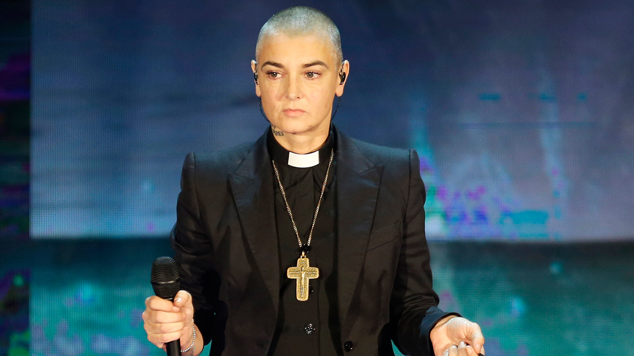 "FILE - In this Oct. 5, 2014 file photo, Irish singer Sinead O'Connor performs during the Italian State RAI TV program ""Che Tempo che Fa"", in Milan, Italy."