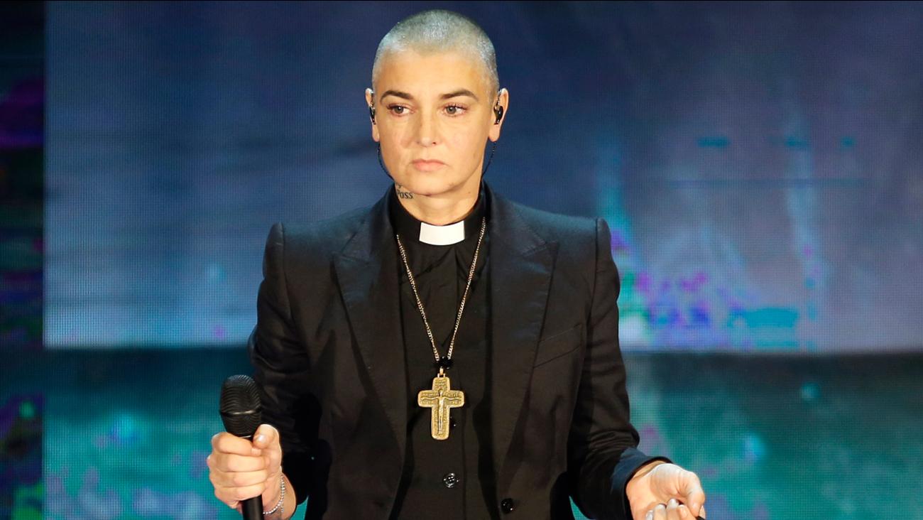 "FILE - In this Oct. 5, 2014 file photo, Irish singer Sinead O'Connor performs during the Italian State RAI TV program ""Che Tempo che Fa"", in Milan, Italy."