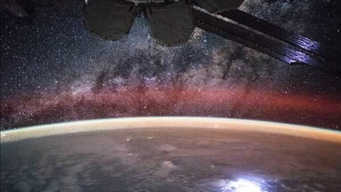 This image taken from a time lapse sequence aboard the space station shows the Milky Way and a lightning strike on Earth.