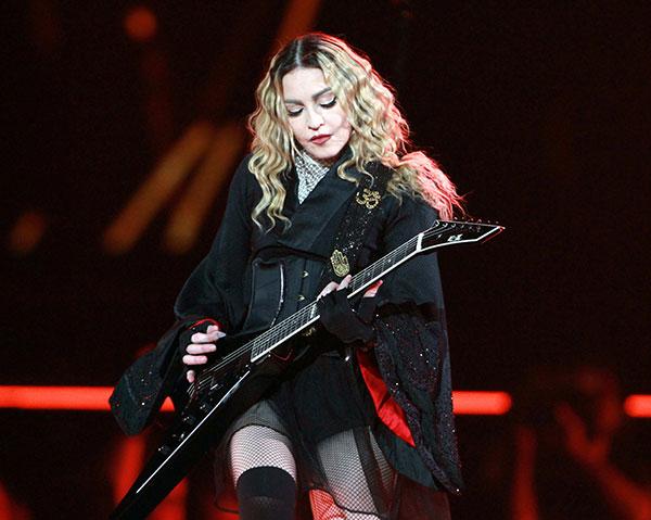 <div class='meta'><div class='origin-logo' data-origin='none'></div><span class='caption-text' data-credit='Robb D. Cohen/Invision/AP'>Madonna will perform a special tribute to Prince.</span></div>