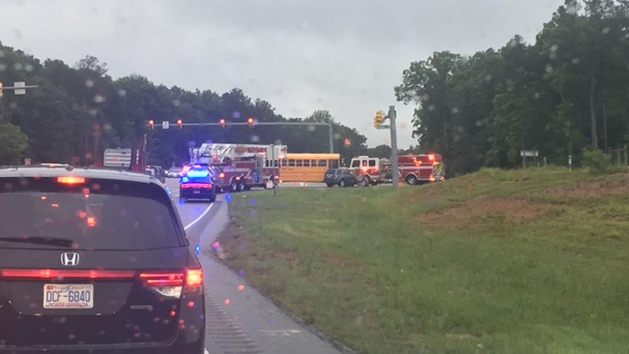 Emergency vehicles at a crash involving a school bus.