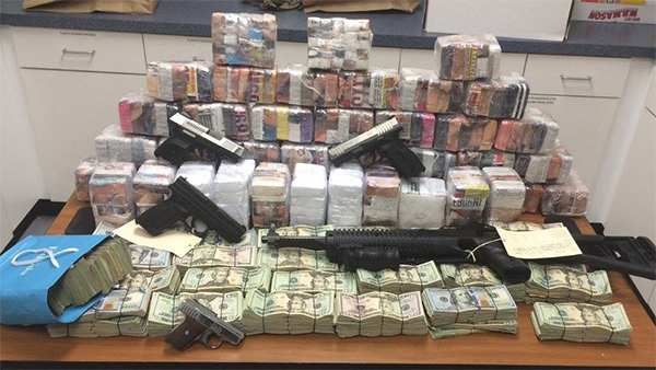"<div class=""meta image-caption""><div class=""origin-logo origin-image none""><span>none</span></div><span class=""caption-text"">Pictured: Drugs, guns, and cash seized in the operation</span></div>"