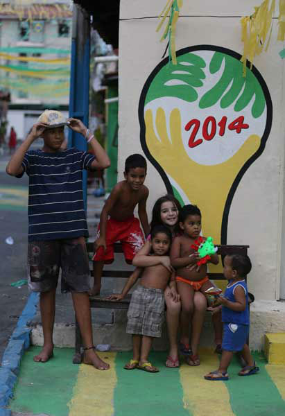 "<div class=""meta image-caption""><div class=""origin-logo origin-image ""><span></span></div><span class=""caption-text"">Children huddle in front of the 2014 soccer World Cup logo in Fortaleza, Brazil (AP Photo/ Martin Mejia)</span></div>"
