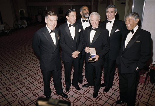 <div class='meta'><div class='origin-logo' data-origin='AP'></div><span class='caption-text' data-credit='AP Photo/Marty Lederhandler'>Dan Rather and the crew of CBS television's 60 Minutes poses March 4, 1988 at New York's Waldorf Astoria after the International Radio and Television Society.</span></div>