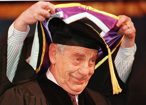 <div class='meta'><div class='origin-logo' data-origin='AP'></div><span class='caption-text' data-credit='AP Photo/Chris Pfuhl'>Veteran newsman Morley Safer of the CBS news magazine show 60 Minutes, smiles as he receives his honors hood at Emerson College graduation, Monday, May 17, 1999 in Boston.</span></div>
