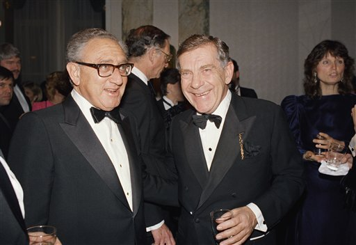 <div class='meta'><div class='origin-logo' data-origin='AP'></div><span class='caption-text' data-credit='AP Photo/Mark Lennihan'>Henry Kissinger, left, and Morley Safer of CBS pose during reception for 60 Minutes given by the International Radio and Television Society, Inc. in New York on March 3, 1988.</span></div>