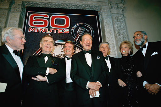 "<div class=""meta image-caption""><div class=""origin-logo origin-image ap""><span>AP</span></div><span class=""caption-text"">The ""60 Minutes"" team poses for photographers at the Metropolitan Museum of Art in New York, Nov.10, 1993. (AP Photo/Mark Lennihan)</span></div>"