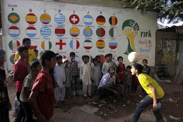 "<div class=""meta image-caption""><div class=""origin-logo origin-image ""><span></span></div><span class=""caption-text"">Pakistani children play soccer during celebrations for the World Cup in Karachi's slums (AP Photo/ Fareed Khan)</span></div>"