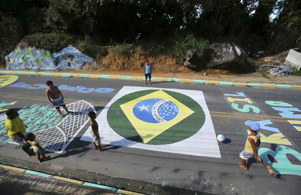 "<div class=""meta image-caption""><div class=""origin-logo origin-image ""><span></span></div><span class=""caption-text"">Children play soccer on a street decorated with World Cup related murals in Mangaratiba, Brazil (AP Photo/ Antonio Calanni)</span></div>"