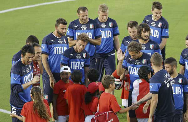 "<div class=""meta image-caption""><div class=""origin-logo origin-image ""><span></span></div><span class=""caption-text"">Members of the Italian national soccer team meet children prior a training session in Natal, Brazil (AP Photo/ Antonio Calanni)</span></div>"