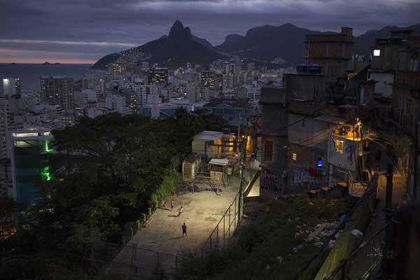 """<div class=""""meta image-caption""""><div class=""""origin-logo origin-image """"><span></span></div><span class=""""caption-text"""">Kids play soccer at the Cantagalo slum in Rio de Janeiro, Brazil (AP Photo/ Felipe Dana)</span></div>"""