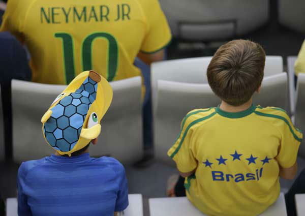 "<div class=""meta image-caption""><div class=""origin-logo origin-image ""><span></span></div><span class=""caption-text"">Children in Brazilian colors watch the group F World Cup soccer match between Iran and Nigeria at the Arena da Baixada in Curitiba, Brazil (AP Photo/ Michael Sohn)</span></div>"