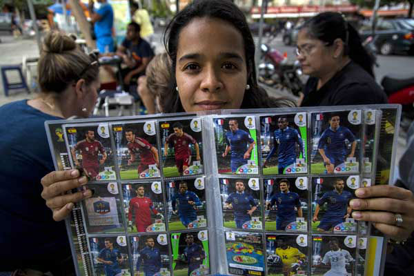 "<div class=""meta image-caption""><div class=""origin-logo origin-image ""><span></span></div><span class=""caption-text"">Hazel Petite shows a 2014 World Cup album edition at a meeting of collectors in Caracas, Venezuela (AP Photo/ Ramon Espinosa)</span></div>"