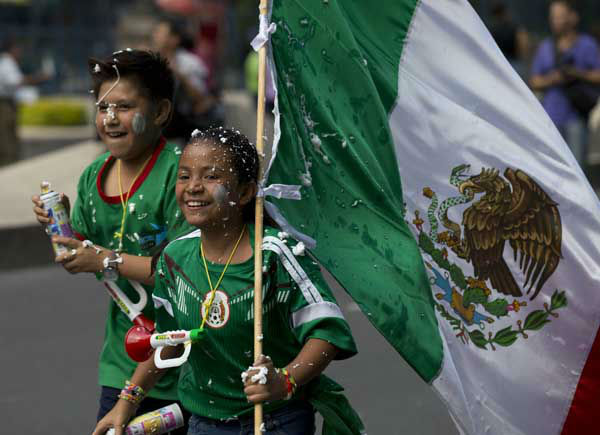 "<div class=""meta image-caption""><div class=""origin-logo origin-image ""><span></span></div><span class=""caption-text"">Young fans of the Mexican national soccer team celebrate by the Independence Monument after their team tied with Brazil in their 2014 World Cup soccer match, in Mexico City (AP Photo/ Rebecca Blackwell)</span></div>"