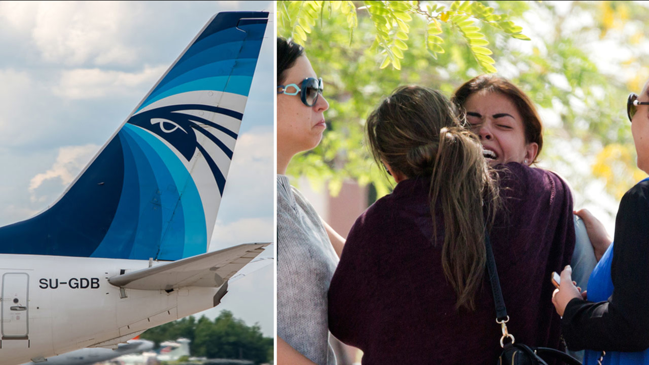 Relatives of passengers on EgyptAir Flight MS804 grieve as they leave the in-flight service building where they were held at Cairo International Airport Thursday, May 19, 2016.