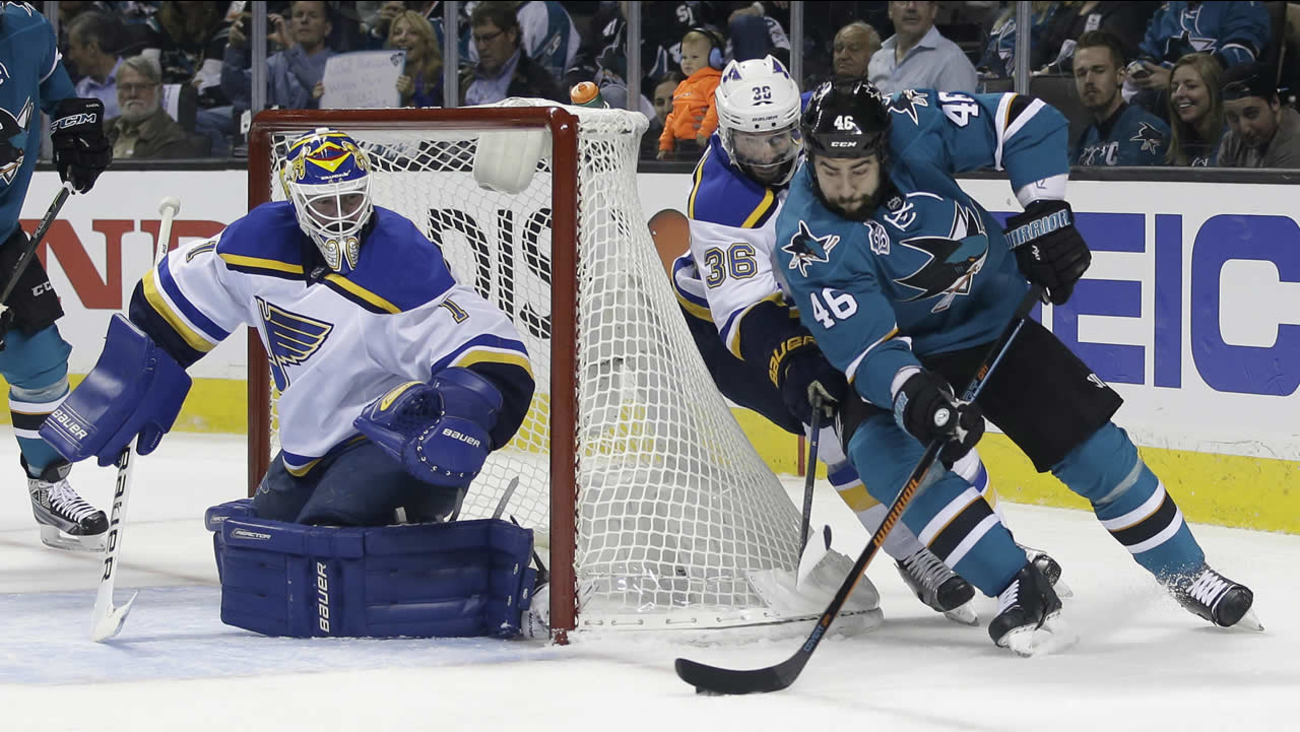 Sharks' Roman Polak skates past Blues' Troy Brouwer during Game 3 of the NHL hockey Stanley Cup Western Conference finals on May 19, 2016, in San Jose, Calif. (AP Photo)