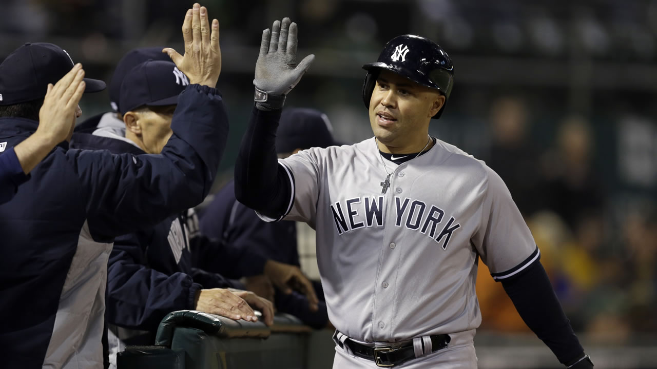 Yankees' Carlos Beltran is congratulated after hitting a two-run home run off Athletics' Fernando Rodriguez during a game on May 19, 2016 in Oakland, Calif. (AP Photo)