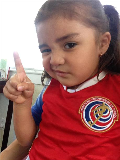 "<div class=""meta image-caption""><div class=""origin-logo origin-image ""><span></span></div><span class=""caption-text"">Amiliana R. rooting for her TICOS!  Keep sending in your World Cup fan photos! (photo submitted by Betsy Cordoba via uReport)</span></div>"