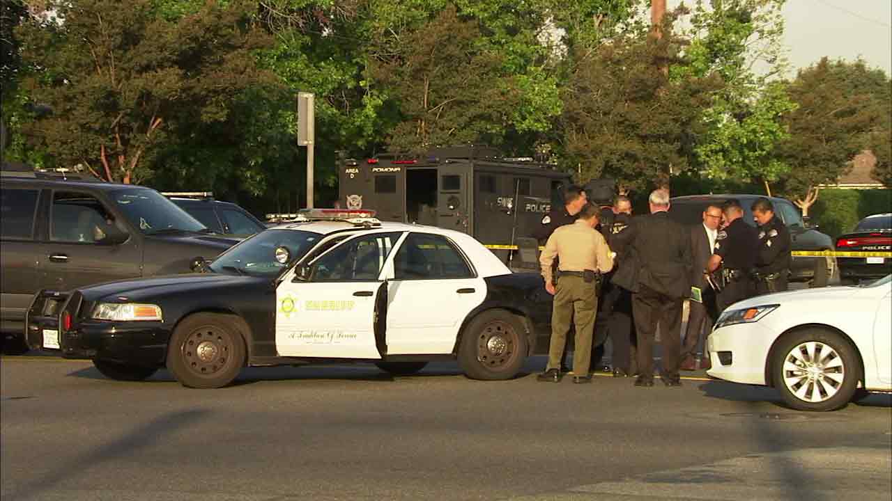 West Covina police and Los Angeles County sheriff's officials investigate an officer-involved shooting in West Covina, Calif., on Saturday, May 21, 2016.