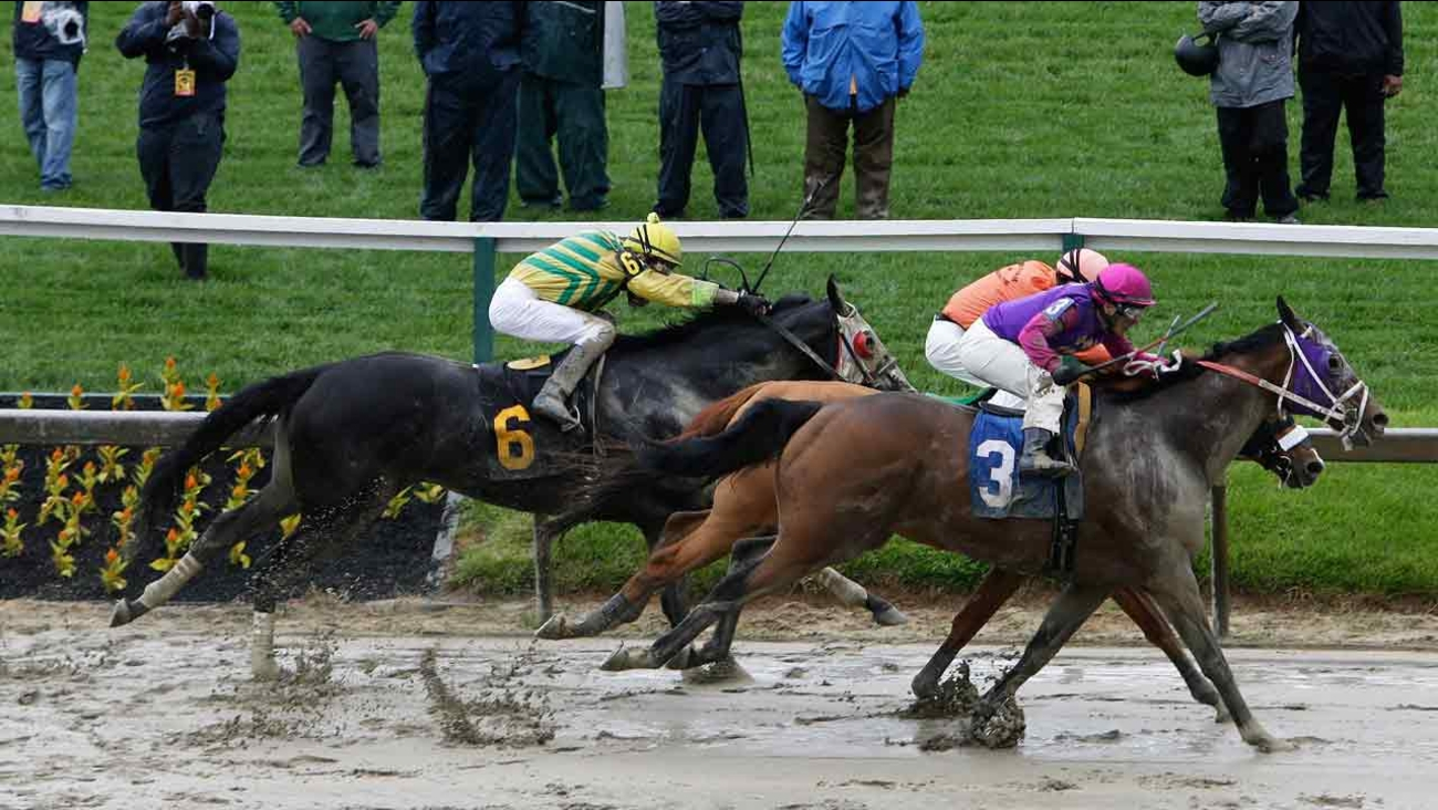 Homeboykris (3), moves to the finish in the first race of the day on a muddy track ahead of the 141st Preakness Stakes horse race at Pimlico Race Course Saturday, May 21, 2016.