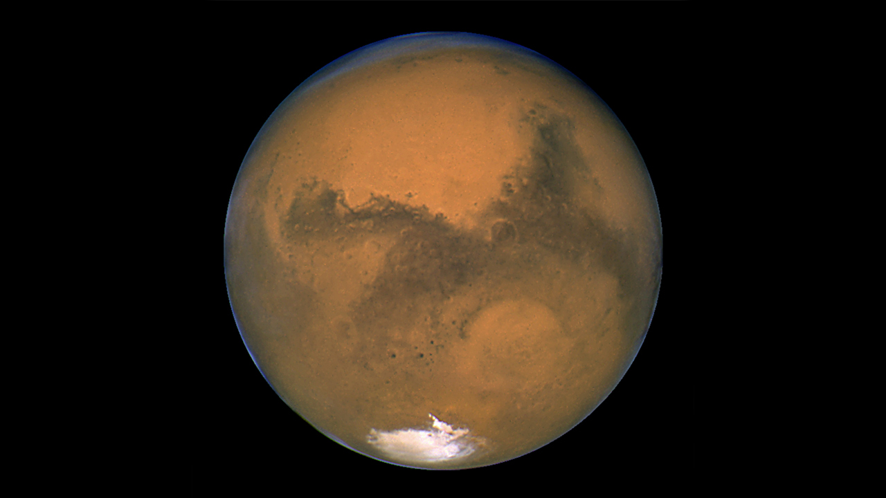This Aug. 26, 2003 image made available by NASA shows Mars as it lines up with the Sun and the Earth. Photographed by the Hubble Space Telescope.