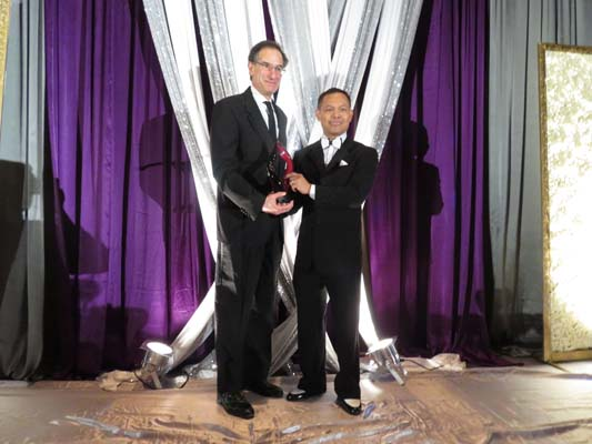 <div class='meta'><div class='origin-logo' data-origin='none'></div><span class='caption-text' data-credit=''>ABC-13 General Manager Mr. Henry Florsheim accepting the Corporate Achievement Award by APAHA President Nelvin Adriatico-Thadhani</span></div>