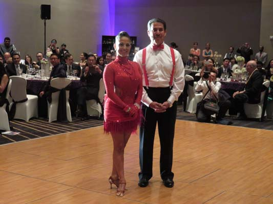 <div class='meta'><div class='origin-logo' data-origin='none'></div><span class='caption-text' data-credit=''>Adrian Garcia with dance partner</span></div>