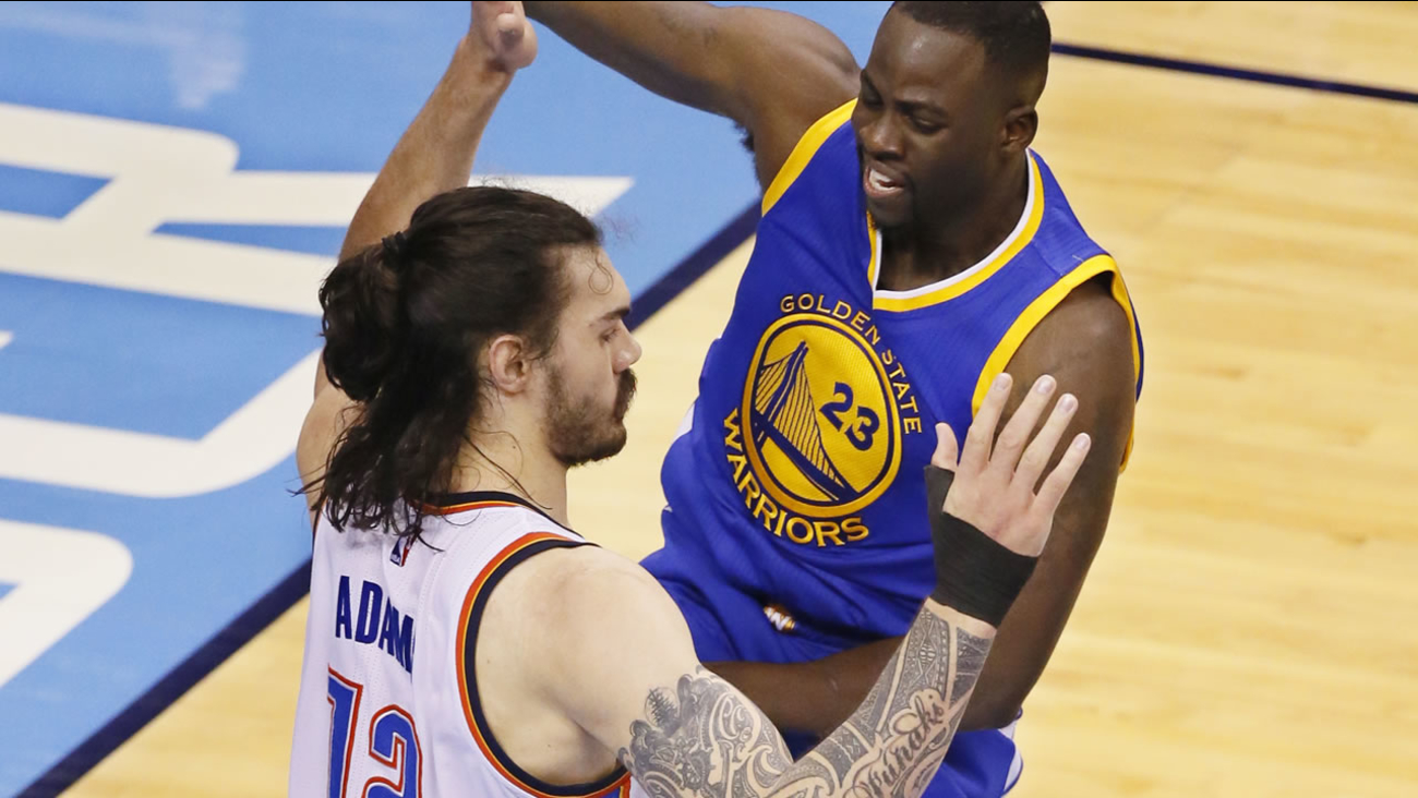 Warriors' Draymond Green fouls Thunder's Steven Adams in the first half in Game 3 of the NBA basketball Western Conference finals in Oklahoma City on May 22, 2016. (AP Photo)