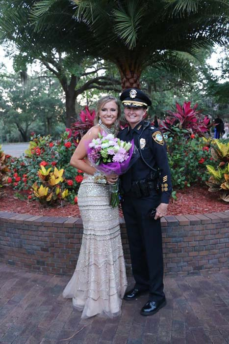 "<div class=""meta image-caption""><div class=""origin-logo origin-image none""><span>none</span></div><span class=""caption-text"">Police officers in Florida escort Aleena Kondek, the daughter of slain officer Charles Kondek Jr., to her high school prom Saturday night. (Tarpon Springs Police Department)</span></div>"