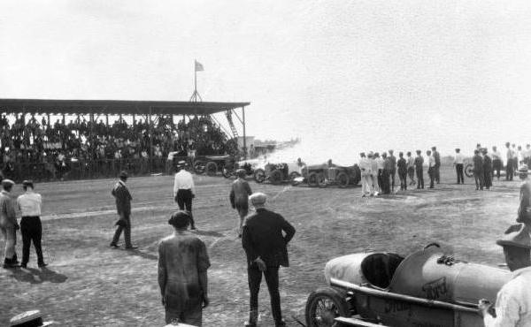 """<div class=""""meta image-caption""""><div class=""""origin-logo origin-image ktrk""""><span>KTRK</span></div><span class=""""caption-text"""">Men and racecars on the track at Bellaire, Texas with spectators at left (Houston Public Library)</span></div>"""