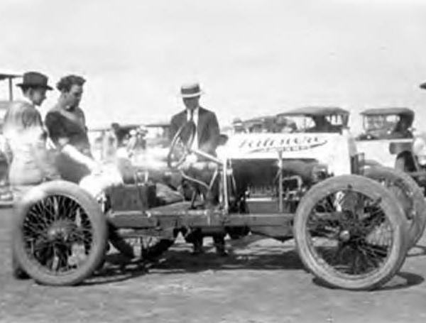 """<div class=""""meta image-caption""""><div class=""""origin-logo origin-image ktrk""""><span>KTRK</span></div><span class=""""caption-text"""">Three men looking at a racecar at Bellaire (Tex.) sometime during the 1920's. In background are open touring cars. White streak across middle of the picture caused by deteriorating (Houston Public Library)</span></div>"""