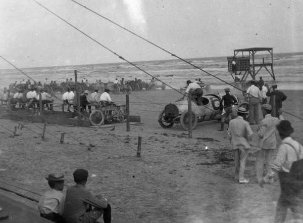 """<div class=""""meta image-caption""""><div class=""""origin-logo origin-image ktrk""""><span>KTRK</span></div><span class=""""caption-text"""">Racing cars and race fans on the track at Galveston, TX. Portion of photograph faded due to film deterioration. Gulf of Mexico visible in distance. During the 1920's. (Houston Public Library)</span></div>"""