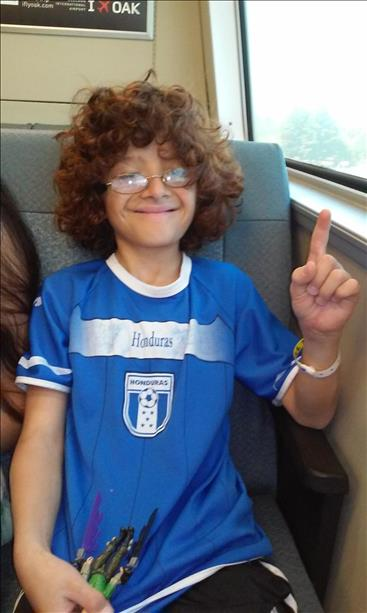 "<div class=""meta image-caption""><div class=""origin-logo origin-image ""><span></span></div><span class=""caption-text"">Marlon supporting Honduras and riding BART on his way to watch the USA game at the Civic Center. Keep sending in your World Cup fan photos! (photo submitted by Jesenia Stewart via uReport)</span></div>"