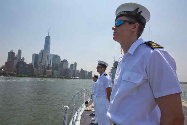 "<div class=""meta image-caption""><div class=""origin-logo origin-image none""><span>none</span></div><span class=""caption-text"">Crew members of Her Majesty Canadian Ship Athabaskan man the rails as they sail past the Lower Manhattan, Wednesday, May 25, 2016 in New York. (AP Photo/Mary Altaffer)</span></div>"