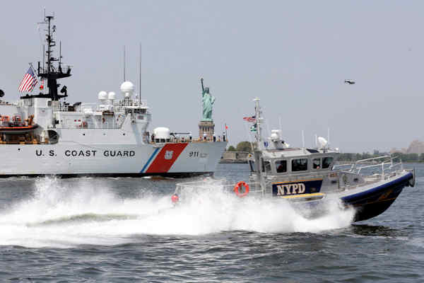 "<div class=""meta image-caption""><div class=""origin-logo origin-image none""><span>none</span></div><span class=""caption-text"">The US Coast Guard Cutter Forward, from Portsmouth, Va., and a New York City Police Department response boat pass the Statue of Liberty in New York, Wednesday, May 25, 2016. (AP Photo/Richard Drew)</span></div>"