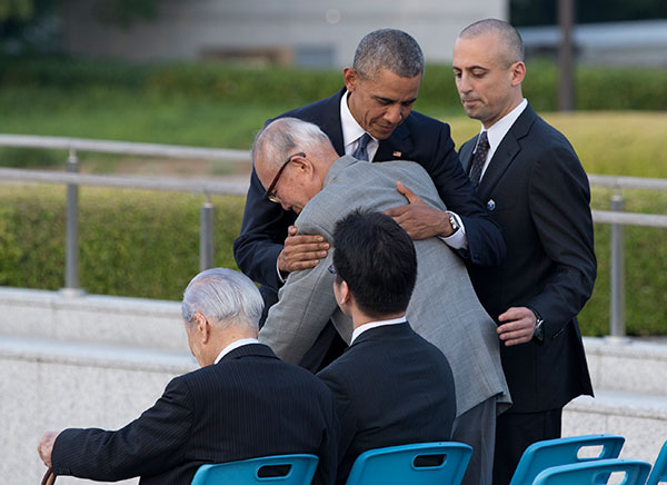 "<div class=""meta image-caption""><div class=""origin-logo origin-image none""><span>none</span></div><span class=""caption-text"">U.S. President Barack Obama hugs Shigeaki Mori, an atomic bomb survivor, historian and creator of the memorial for American WWII POWs killed at Hiroshima. (Carolyn Kaster/AP Photo)</span></div>"