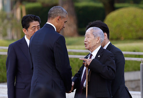 "<div class=""meta image-caption""><div class=""origin-logo origin-image none""><span>none</span></div><span class=""caption-text"">Obama shakes hands and talks with Sunao Tsuboi, a survivor of the 1945 Atomic Bombing and chairman of the Hiroshima Prefectural Confederation of A-bomb Sufferers Organization. (Carolyn Kaster/AP Photo)</span></div>"