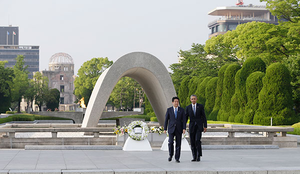 "<div class=""meta image-caption""><div class=""origin-logo origin-image none""><span>none</span></div><span class=""caption-text"">President Obama and Japanese Prime Minister Shinzo Abe walk after laying wreaths at the cenotaph at the Hiroshima Peace Memorial Park (Carolyn Kaster/AP Photo)</span></div>"