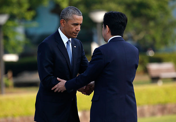 "<div class=""meta image-caption""><div class=""origin-logo origin-image none""><span>none</span></div><span class=""caption-text"">President Barack Obama, left, shakes hands with Japanese Prime Minister Shinzo Abe after laying a wreath at Hiroshima Peace Memorial Park in Hiroshima. (Shuji Kajiyama/AP Photo)</span></div>"