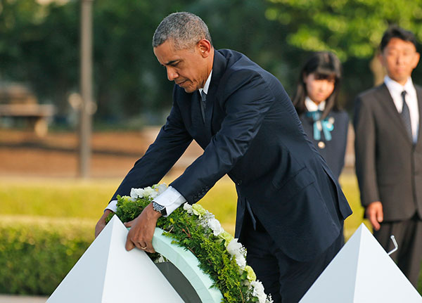 "<div class=""meta image-caption""><div class=""origin-logo origin-image none""><span>none</span></div><span class=""caption-text"">U.S. President Barack Obama lays wreaths at the cenotaph at Hiroshima Peace Memorial Park in Hiroshima. (Shuji Kajiyama/AP Photo)</span></div>"