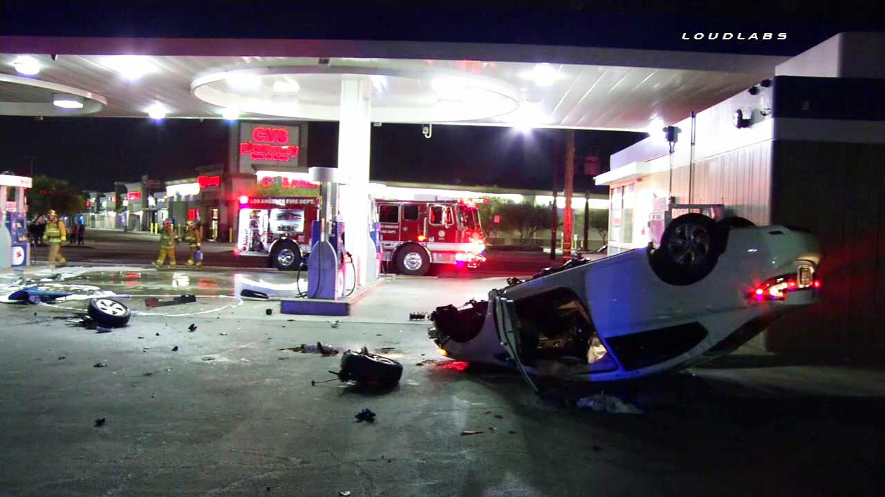 A car landed on its roof after slamming into a gas station pump in Panorama City on Friday, May 27, 2016.