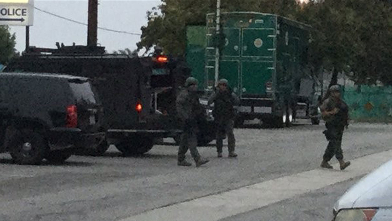 LASD Special Enforcement Bureau members end an armed standoff with a suspect in Cudahy on Saturday, May 28, 2016.