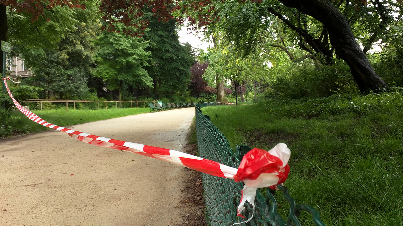 White-and-red tape is strung across a sandy pathway through Park Monceau after a lightning strike, in Paris, Saturday, May 28, 2016.