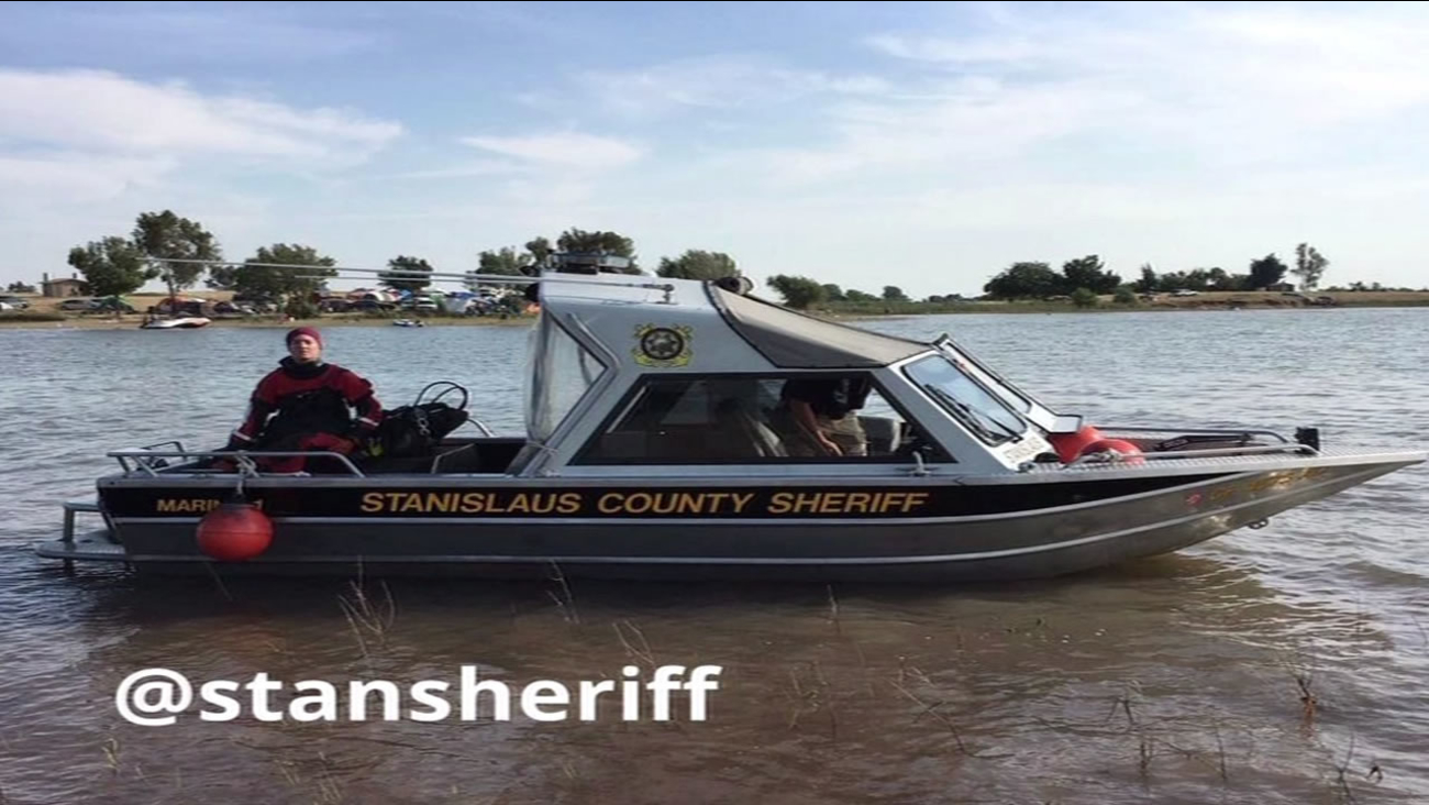 This image shows Stanislaus County deputies searching the Woodward Reservoir in Oakdale, Calif.  after two Oakland teenagers went missing while swimming on May 28, 2016.