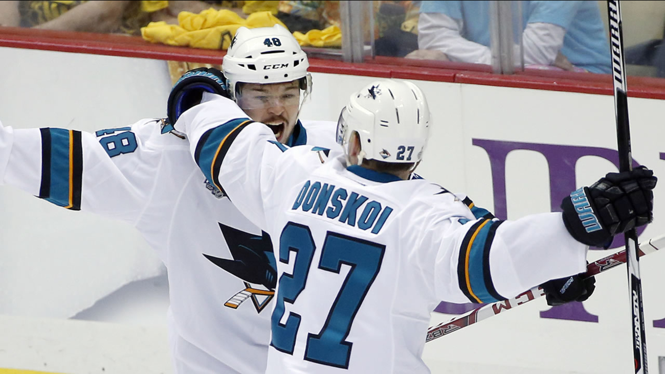 San Jose Sharks' Tomas Hertl, left, celebrates his goal against the Pittsburgh Penguins with Joonas Donskoi in Game 1 of the Stanley Cup final series Monday, May 30, 2016, in Pittsburgh.